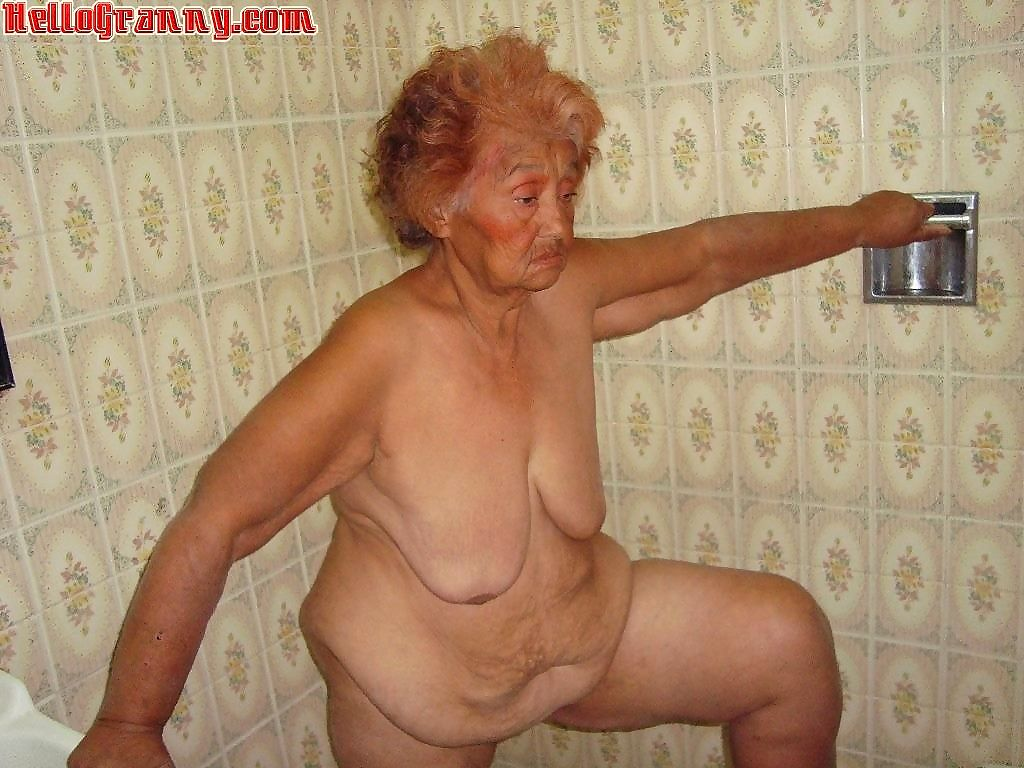 Painted granny in the shower plays with her boobs - part 3891