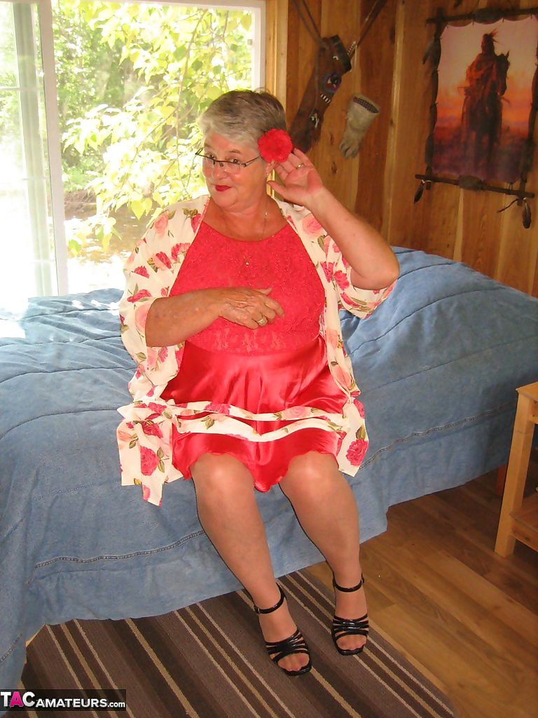 Short haired granny Girdle Goddess stripping to her stockings and high heels