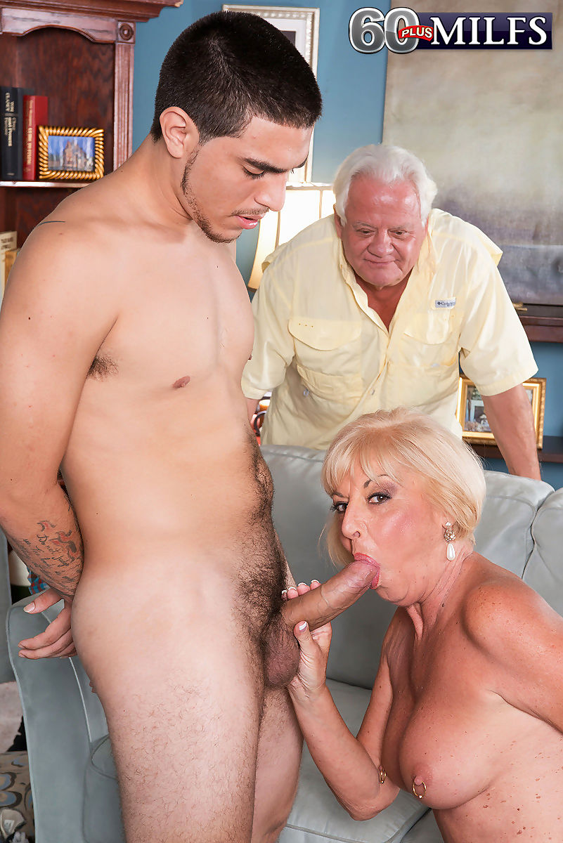 Hot granny Scarlet Andrews fucks a younger boy while her husband watches