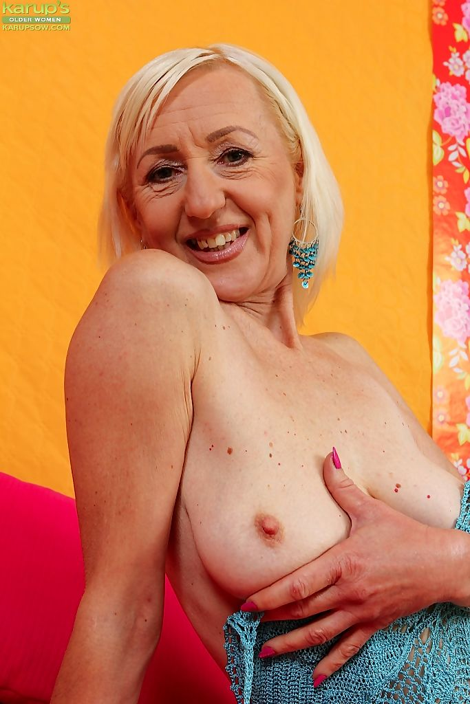 Mature horny blonde Tina showing saggy tits and toying with dildo close up
