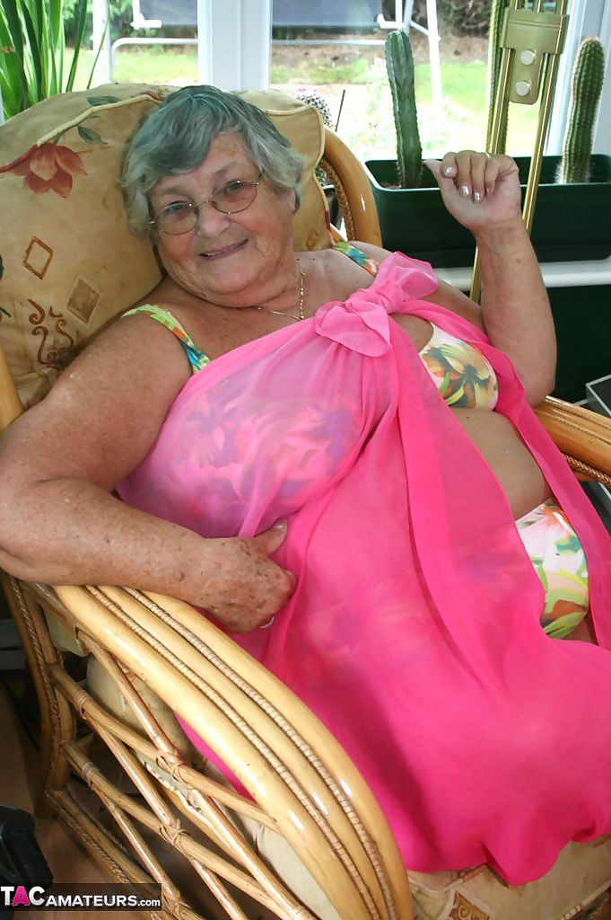 Horny old granny in glasses disrobes to reveal huge saggy tits & big BBW ass