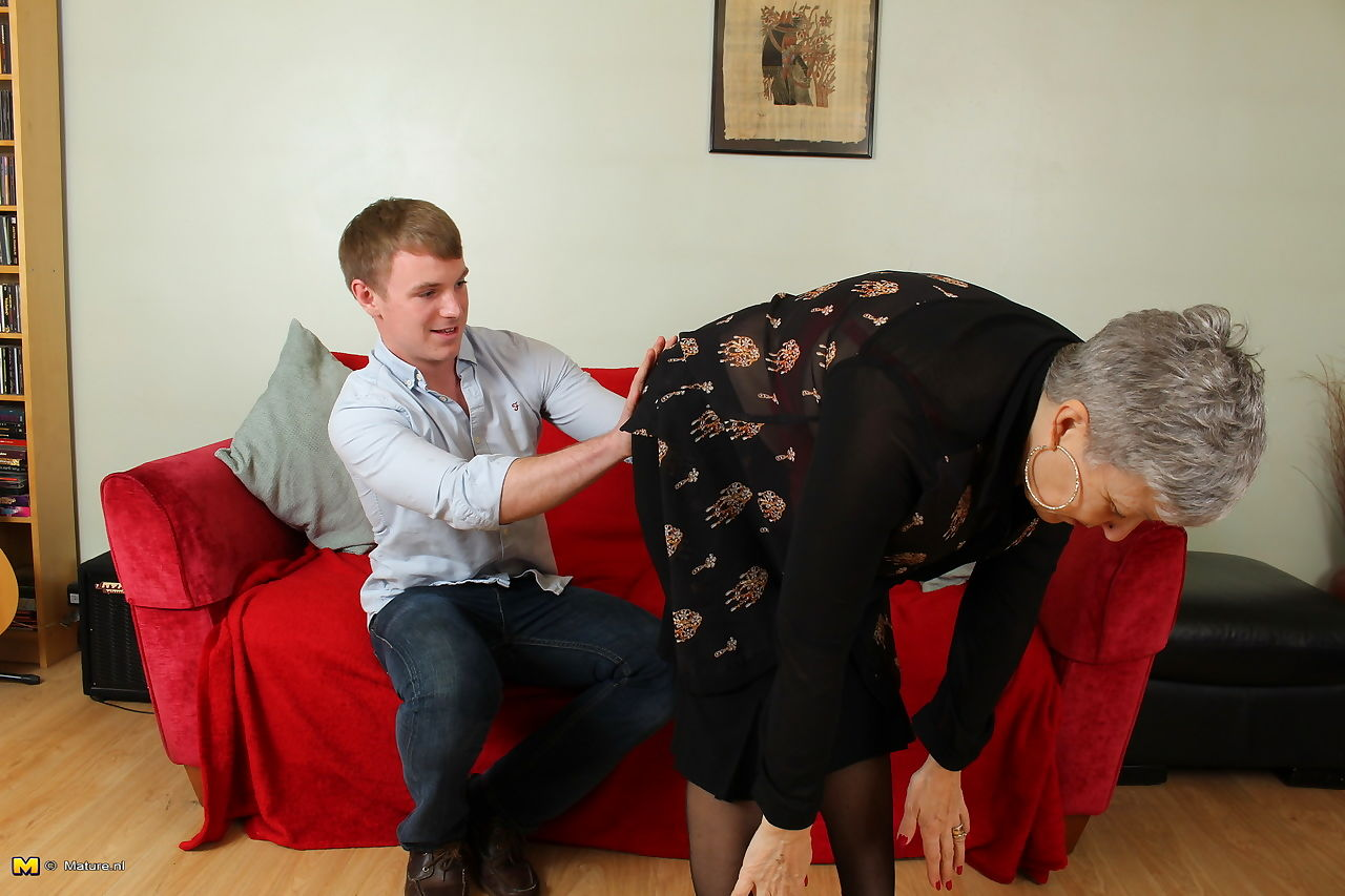 Cheating British housewife gets fucked by her young lover on a sofa