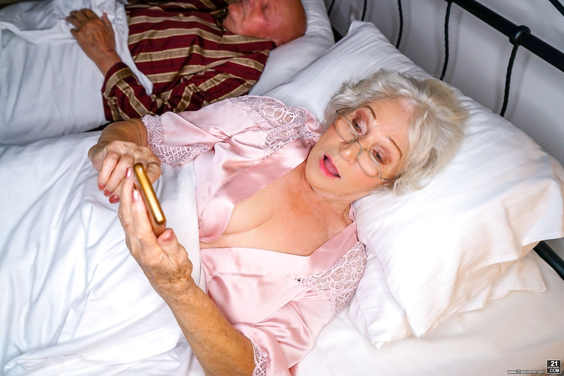 Horny granny norma is in her bed when she gets a call - part 1253