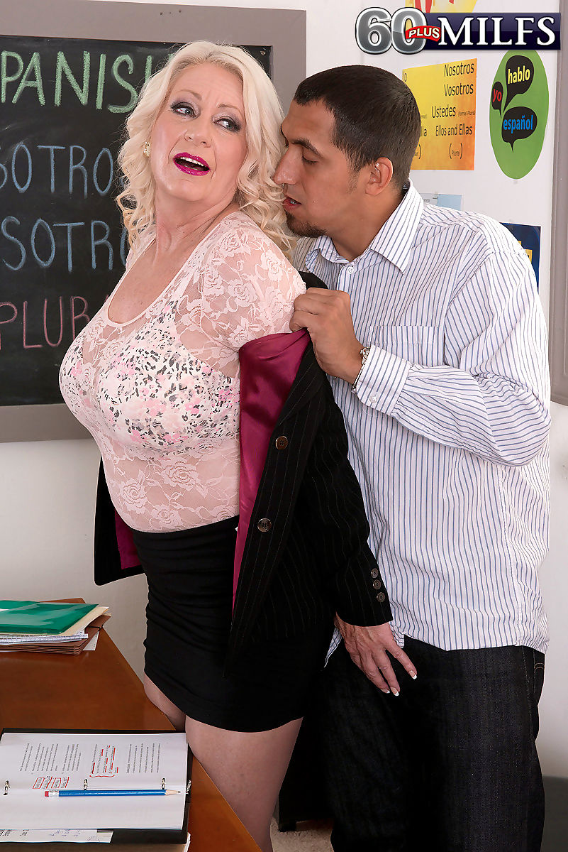 Fat horny mom bares her big melons to give younger teacher a classroom titjob