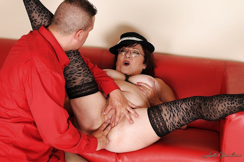 Fatty granny in glasses gets a facial cumshot after hardcore fucking