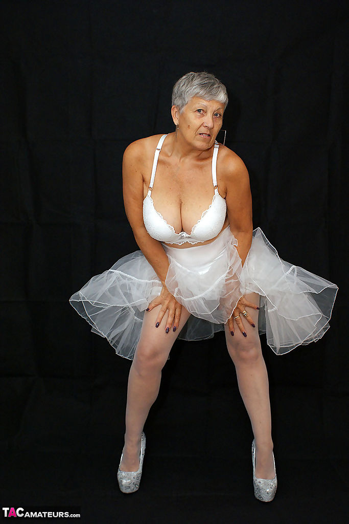 Brazen plump granny Savana flashes panty upskirt in tutu & sparkly high heels