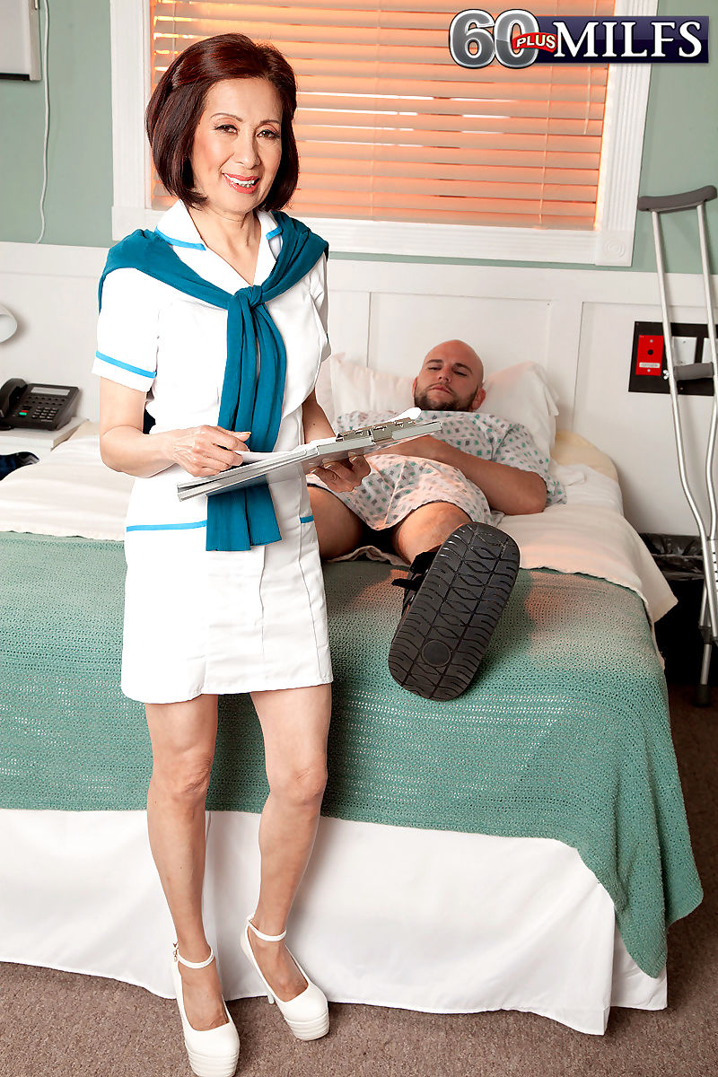 Hot granny Kim Anh spoons with a hung male patient in the hospital