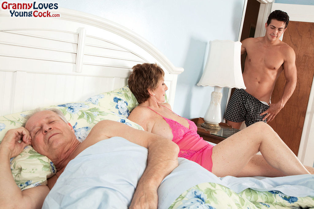 Short haired granny Bea Cummins fucks a young man while her husband watches