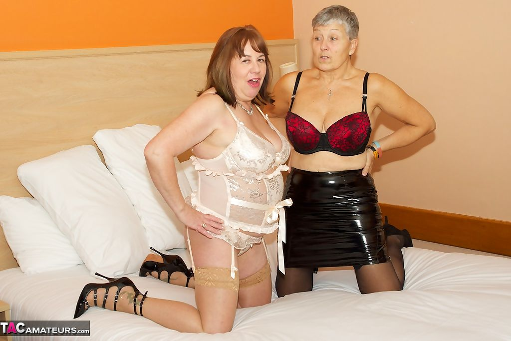 Two lovely grannies in provocative lingerie go topless in bed