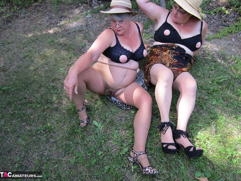 Older granny Girdle Goddess & her aged gal pal showing ass & nipples outdoors