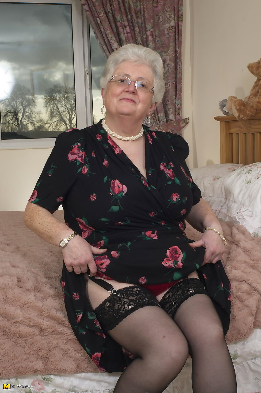 Older granny is still horny and plays with her fatty pussy on the bed
