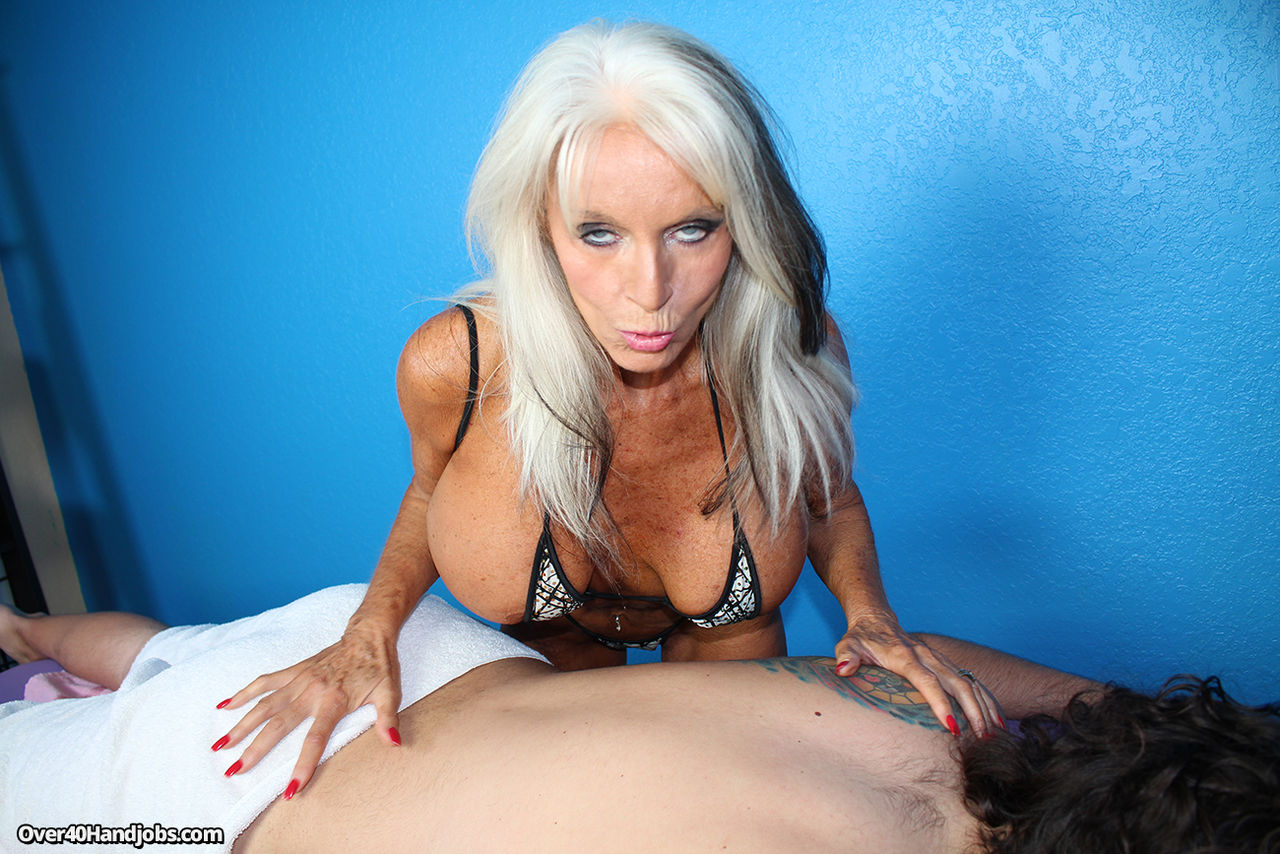 Big boobed granny Sally Dangelo jerks a dick until the sperm flows