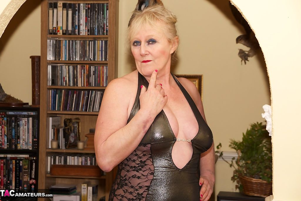 Insatiable granny Claire Knight fingers her mature muff in provocative outfit