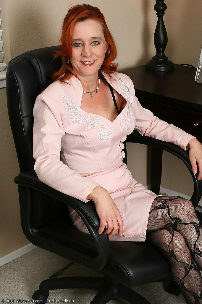 Redheaded office girl looks great naked at 53 years old - part 1737