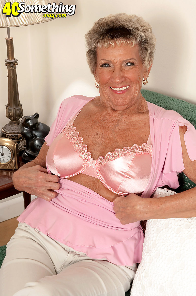 70 plus granny Sandra Ann bares her big tits as she undresses in living room