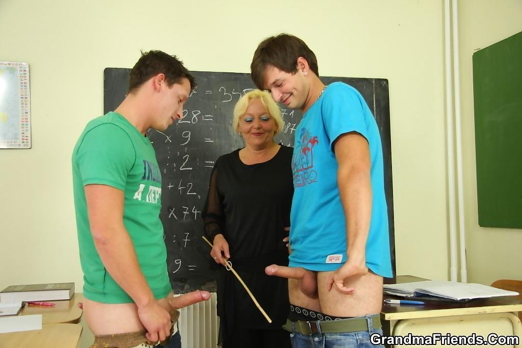 The chubby mature teacher is fucked by two of her naughty students in class - part 3