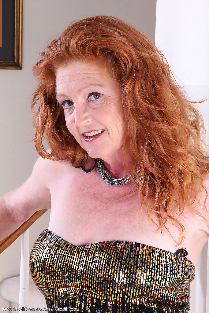 Hot redhead granny Tami Estelle flaunts small saggy tits & smooth bald pussy