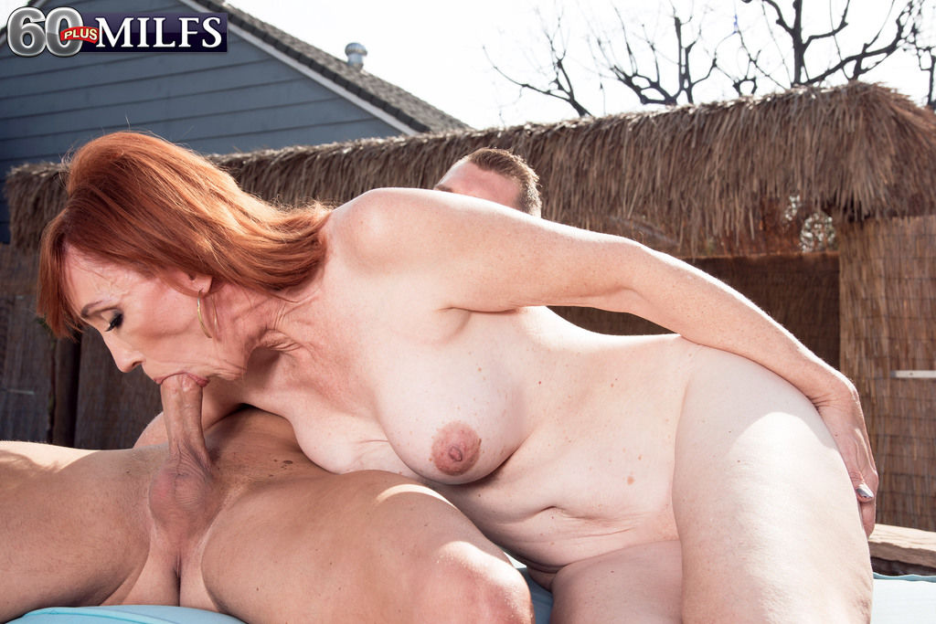 Natural redheaded granny Diamond Red bangs the pool boy after giving him nead
