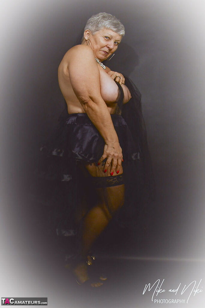 Hot granny Savana modeling her plump physique in revealing sexy lingerie