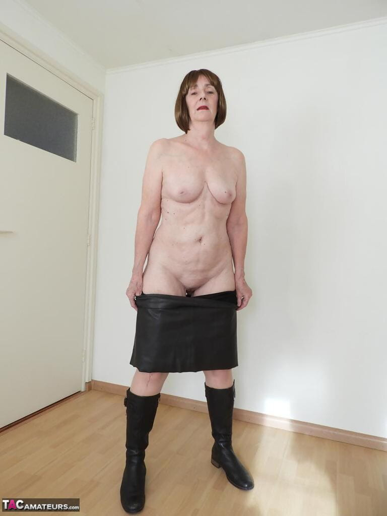 Hot granny Kat Kitty masturbates after riding exercise bike in tan stockings