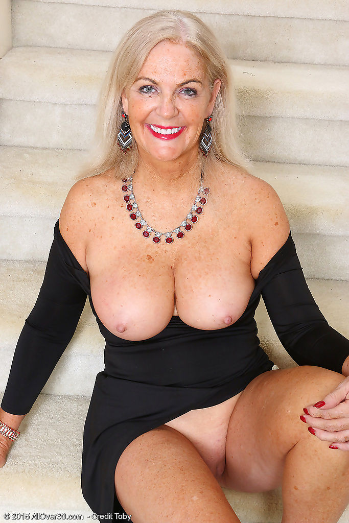 Classy mature judy mayflower shows big breasts & spreads naked on the stairs - part 631