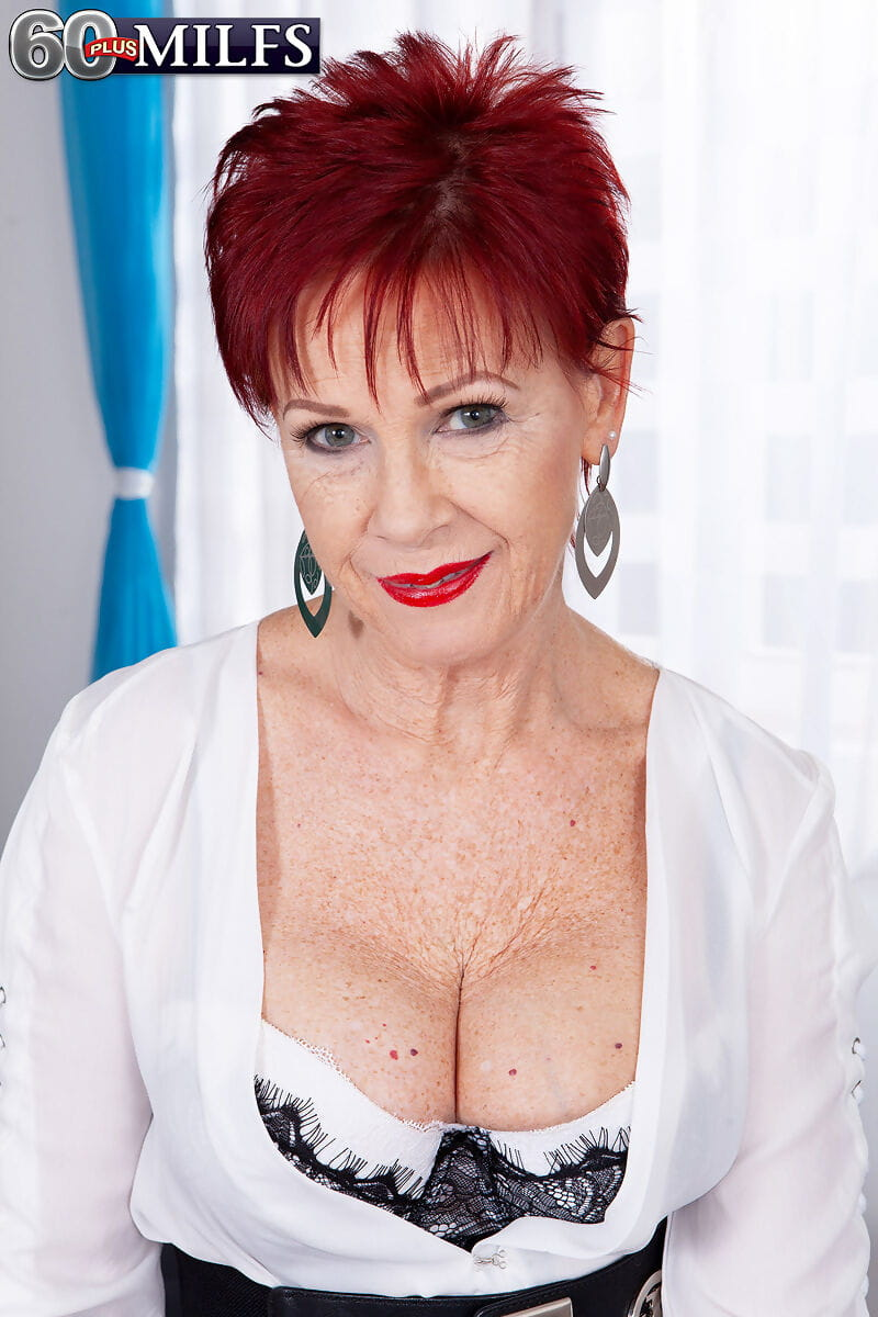 Redhead nan Caroline Hamsel slides her panties aside to seduce a younger man