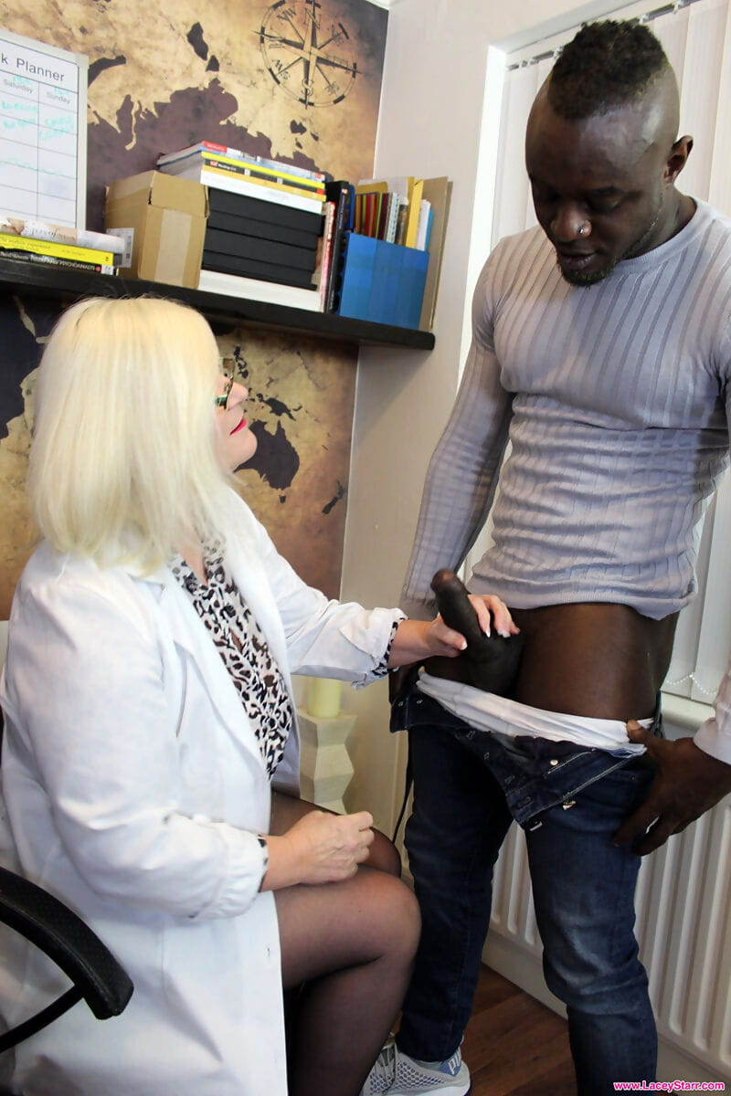 Horny granny Lacey Starr gets banged by a black stud in her office