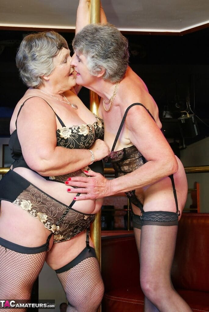 Old fat women in 3 piece lingerie and nylons go lesbian inside strip club