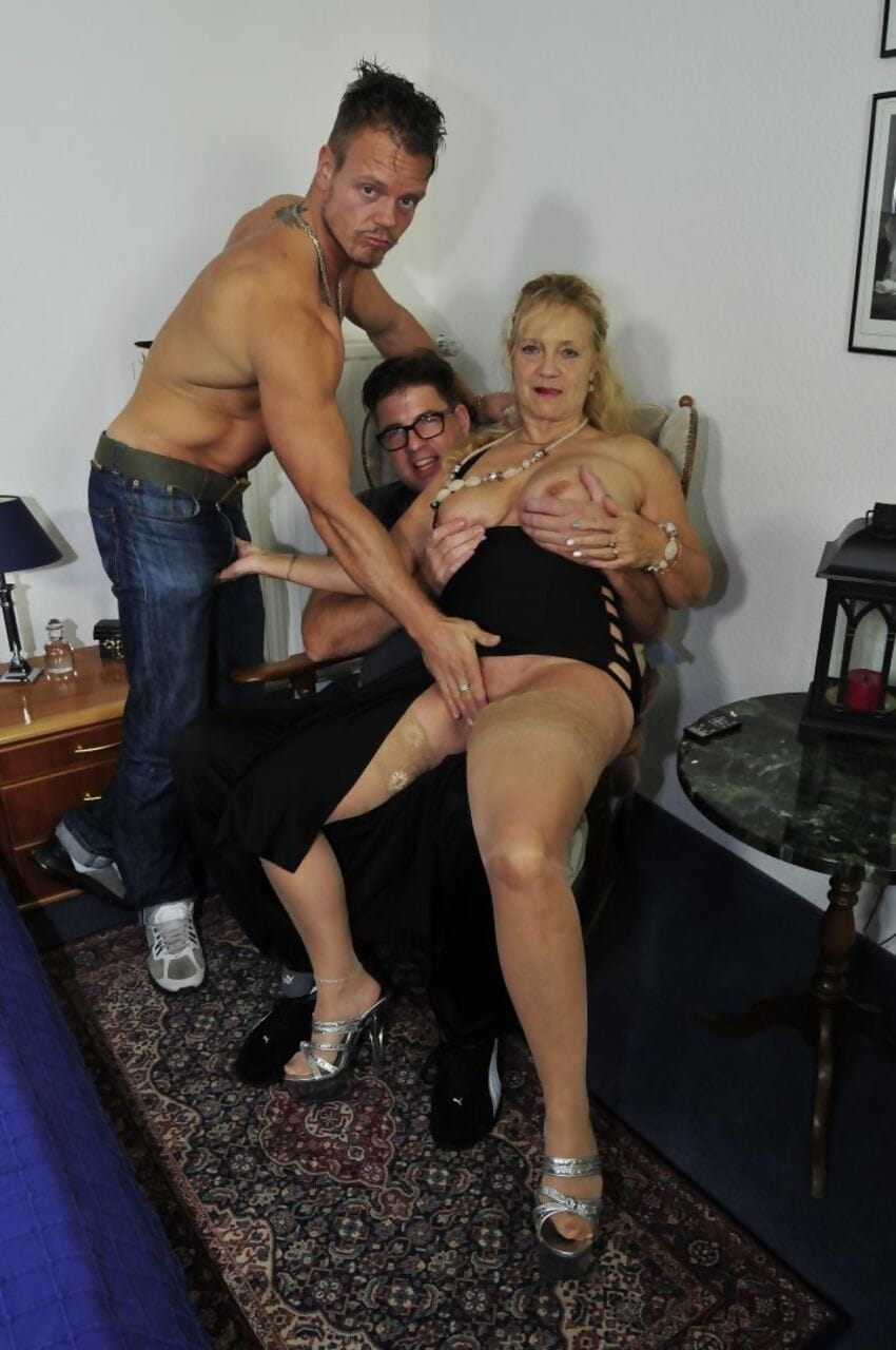 Older blonde lady Beate G sucks the jizz from cocks during a MMF threesome
