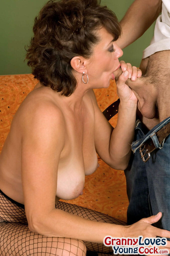 Busty grandmother Jamy Nova blows a younger guy wearing mesh pantyhose