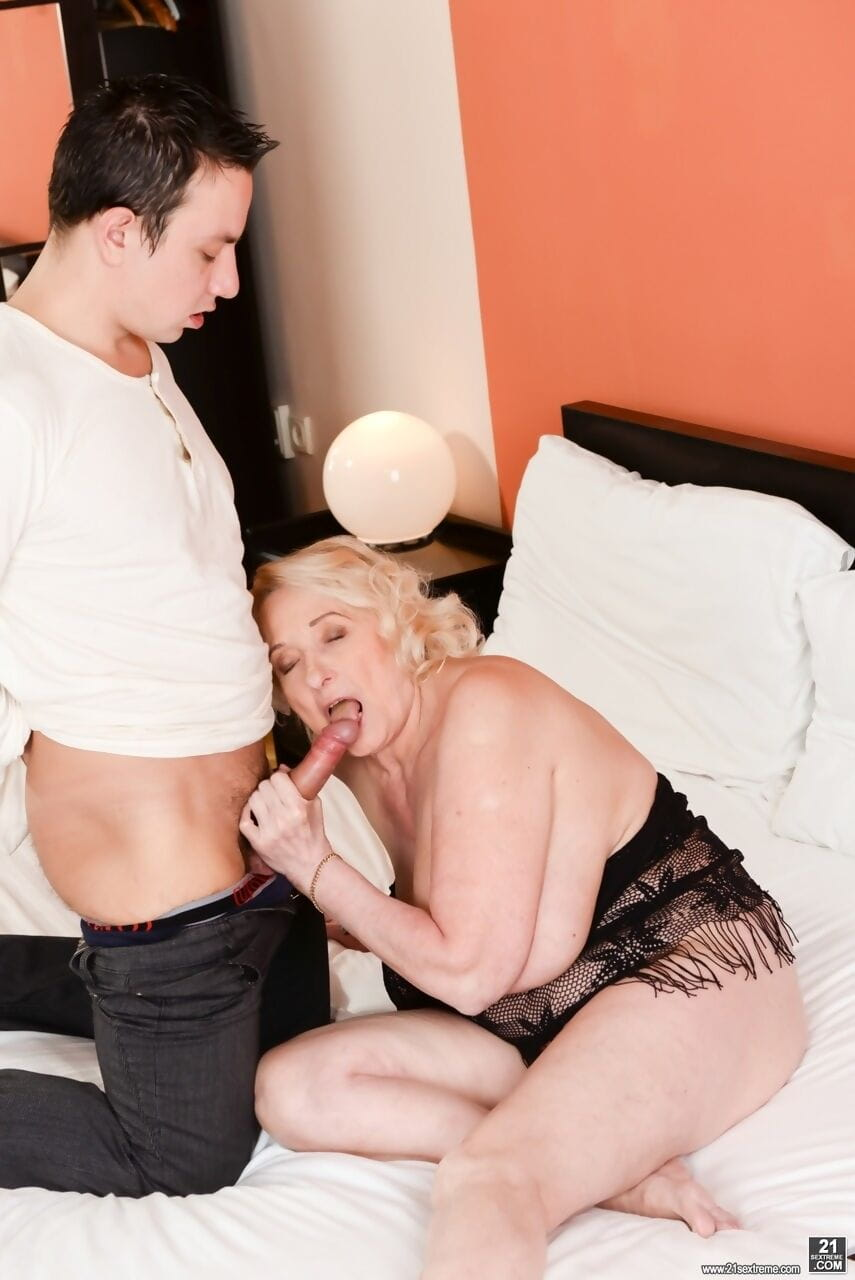 Blonde granny with big tits sucks cock and gets it deep in her crotch