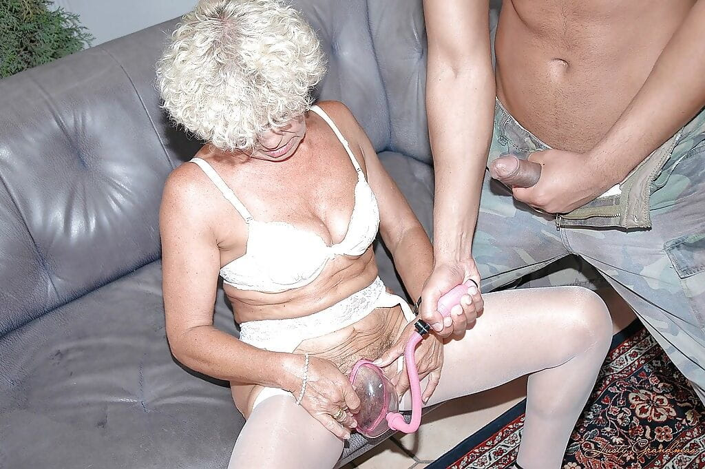 Lustful granny in white stockings gets her cunt drilled by a fat cock