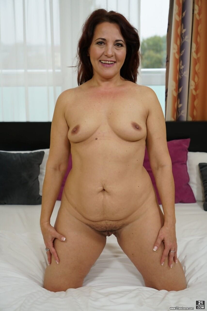 Lusty MILF Red Marie strips her lingerie and spreads her hairy pussy wide