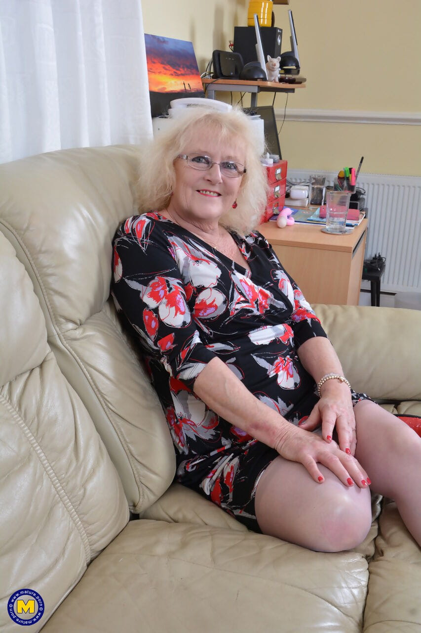 Old British lady in lingerie and tan nylons pleases herself with a vibrator