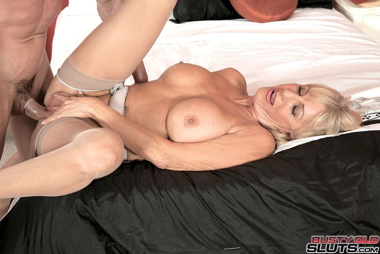 Blonde MILF Pheonix Skye wears stockings while shes enjoying a hard cock