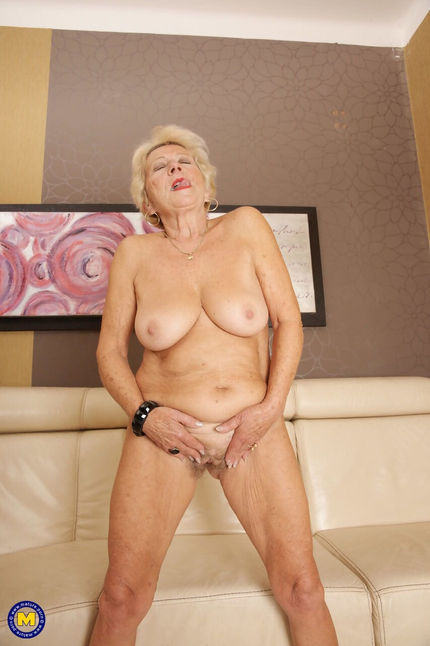 Slutty granny Marina T strips off her clothes and fingers her mature holes