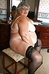 Fat grandmother with short grey hair has phone sex in black stockings only