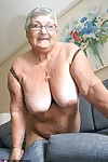 Huge fatty granny baring her saggy boobs & spreading her horny pussy wide open