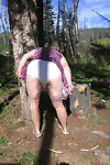 Fat granny Girdle Goddess loses her purple outfit in the woods and poses nude