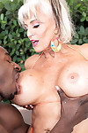 Hot granny Sally DAngelo tit fucks a big black dick with her knockers