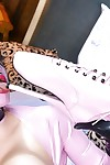 Latex adorned fetish model Latex Lucy posing in granny boots and corset - part 2