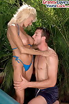 Big titted aged lady Sasha Samuels seduces a younger guy in an outdoor hot tub