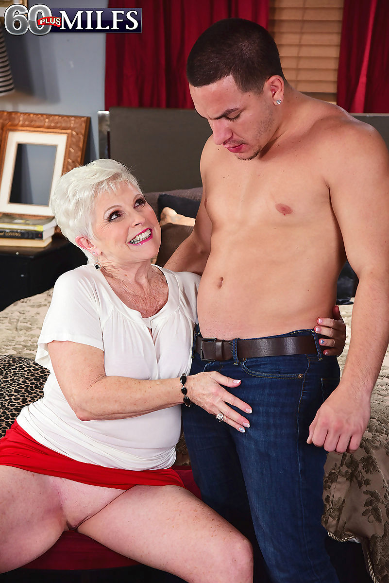 Horny granny Jewel seduces a younger boy with an up skirt panty flash