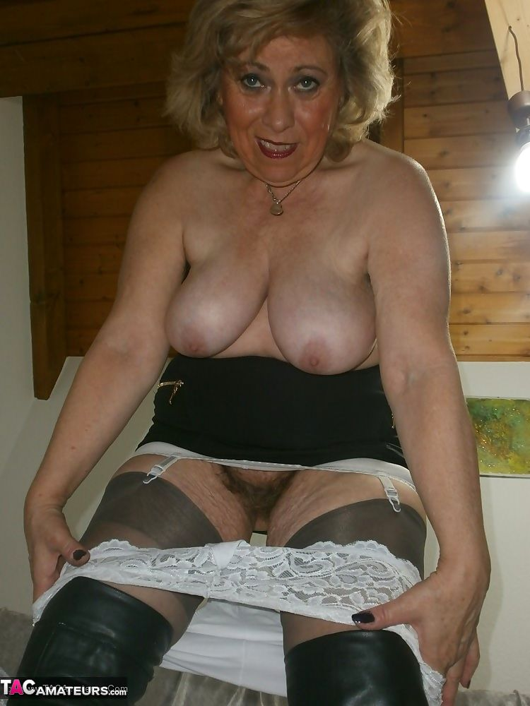 Mature lady next door in black boots Caro uses a huge dildo on her hairy twat
