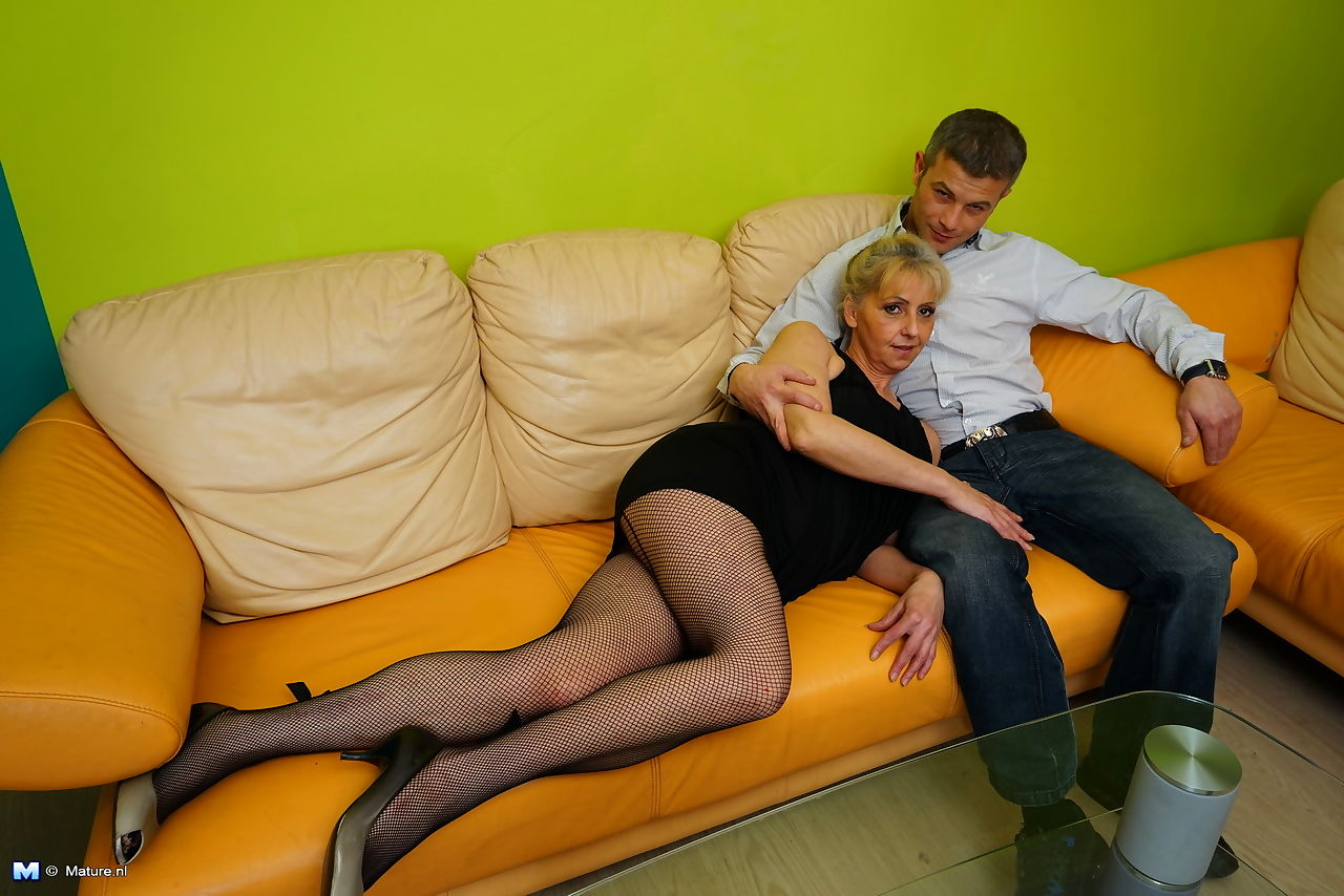 Horny mature granny straddles her young lover boy for kissing & licking
