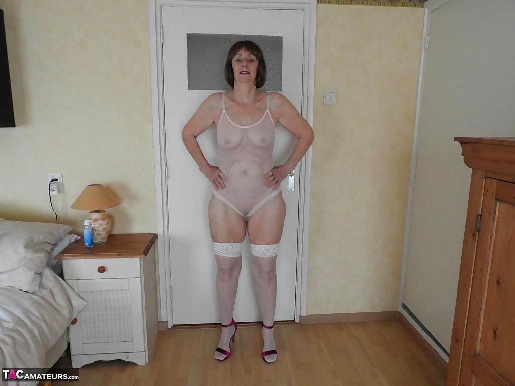 Hot granny Kat Kitty in sheer white lingerie toying her wet pussy with dildo