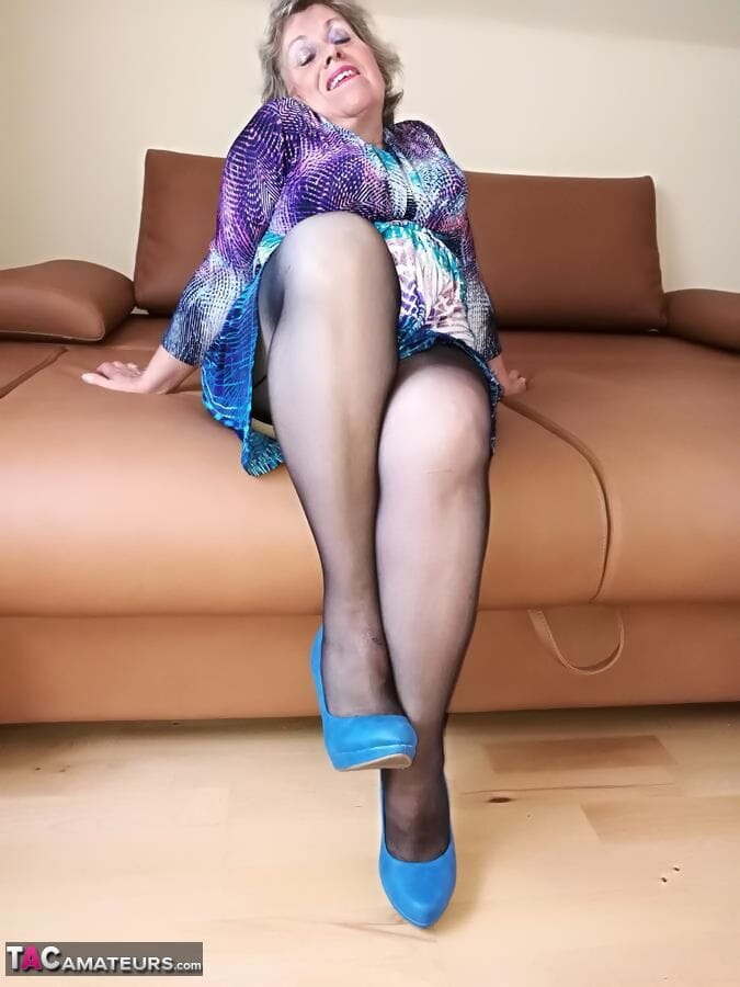 Naughty granny exposes her boobs while changing attire in nylons and heels