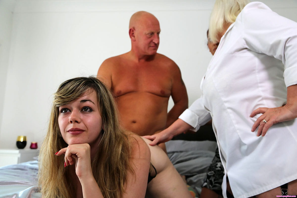Horny old woman helps a younger couple solve their sex problems in the bedroom