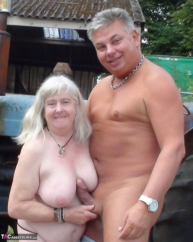 Fat granny takes a cumshot on large tits after sex on the farm